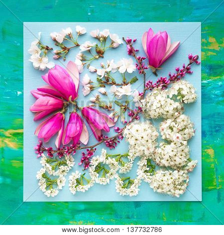 Spring blossoms floral arrangement in zentangle style on abstract painting background.