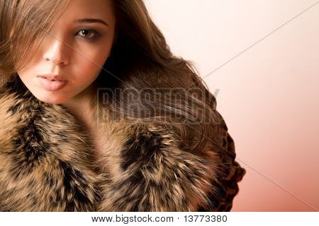 Elegant lady dressed in fashionable clothes looking at camera