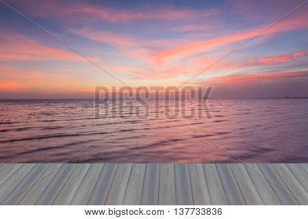 Opening wooden floor, beautiful sky over seacoast, natural landscape background