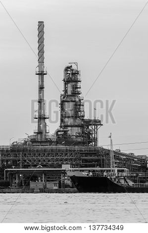 Black and White, Oil refinery riverfront close up