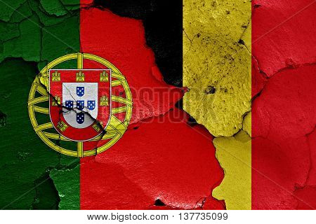 Flags Of Portugal And Belgium Painted On Cracked Wall