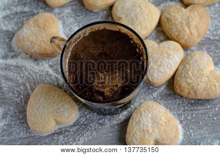 Strong espresso coffee with heart shaped cookies