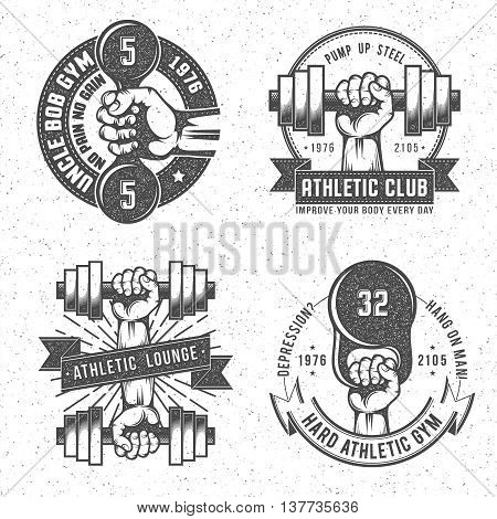 Vintage gym and fitness club emblems with letterpress or rubber stamp effect. Isolated vector illustration. Background on separate layer.