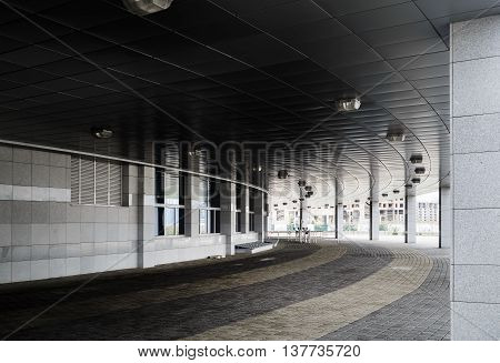 MINSK BELARUS - MAY 03 2016: Minsk-Arena - a sports and entertainment complex in the city of Minsk Belarus. Colonnade and paving slabs under the building hockey stadium.