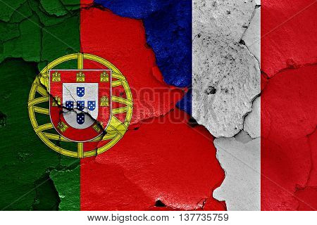Flags Of Portugal And France Painted On Cracked Wall