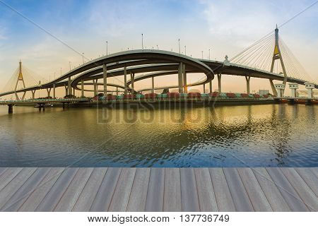 Opening wooden floor, Panorama twin suspension bridge connect to highway interchanged river front and reflection