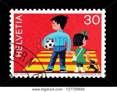 SWITZERLAND - CIRCA 1969 : Cancelled postage stamp printed by Switzerland, that shows Children at pedestrian crosswalk.