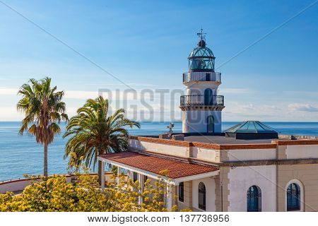 The famous lighthouse near Calella Costa Brava Spain overlooking the blue Mediterranean Sea.