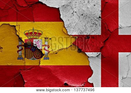 Flags Of Spain And England Painted On Cracked Wall