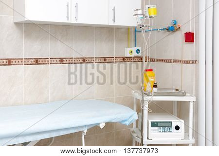 Hospital ward with medical equipment and medical dropper