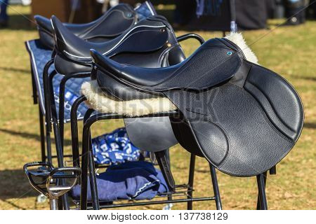 Saddles new equestrian equipment for rider clients.