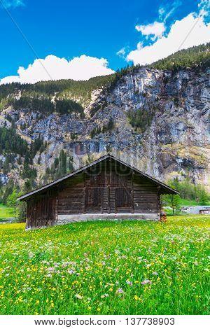 Old chalet on green mountain slope. Swiss Alps. Lauterbrunnen Switzerland Europe