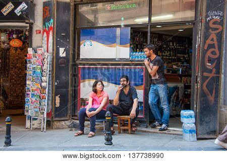 Istanbul Turkey. July 15 2014. Young adults are hanging out on the street in the Beyoglu district of Istanbul.