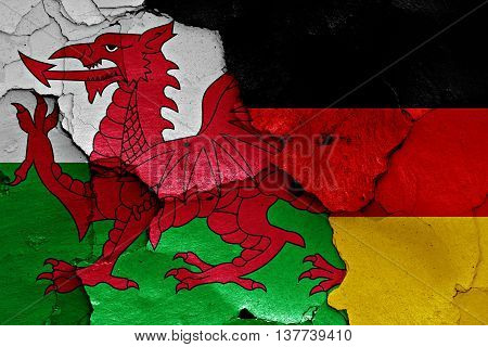 Flags Of Wales And Germany Painted On Cracked Wall