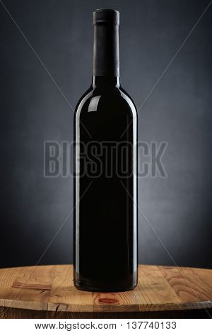 Bottle Of Wine On A Wooden Table On Gray Background