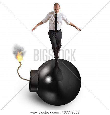 Man walks over bomb with lit fuse