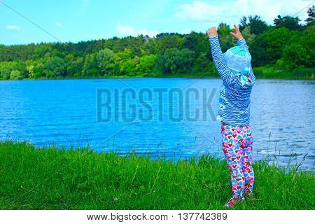 baby is happy near the river in the forest