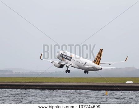 Sydney - February 26 2016: Big passenger Airbus A320-232 Tiger Airways Australia takes off on runway at Sydney Airport February 26 2016 Sydney Australia