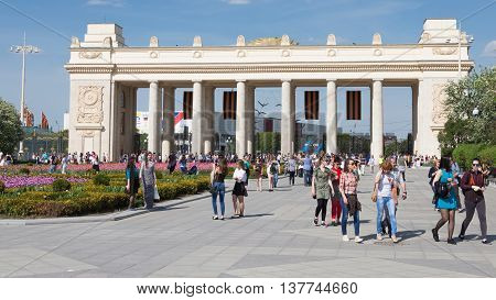 Moscow - May 9 2016: A lot of people and tourists walk in Gorky Park near the main entrance and beautiful flower beds in the spring of May 9 2016 Moscow Russia