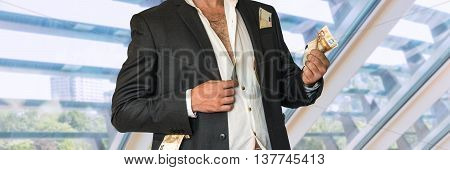 Disheveled Businessman In A Black Suit And Money In Pockets