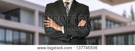 Man In Black Suit With Folded Hands