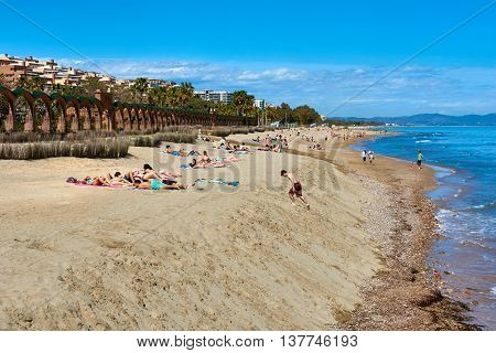 Oropesa del Mar Spain - March 29 2016: People sunbathing on the Marina d'Or beach. It is one of Castellon's most developed beach resorts. Spain