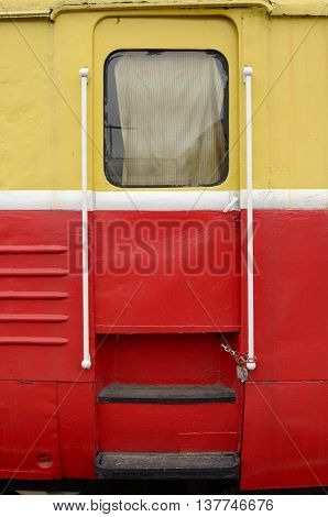 The train stops in depot.Its iron door is locked.