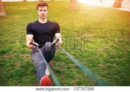 Man Exercising With Resistance Band