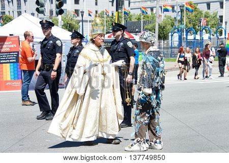 San Francisco CA - June 25 2016: Unidentified participants celebrates at the 46th annual San Francisco Gay Pride Festival held at Civic Center in downtown San Francisco. Heavy police presence patrolling the event.