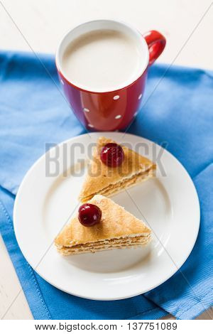 Sponge Cake With Cherries On A Plate And Cup Of Coffee