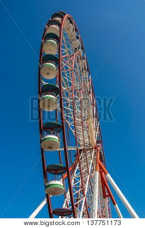 Underside View Of A Ferris Wheel On Sky Background