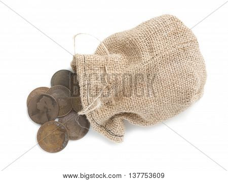 Canvas bag with old copper coins isolated on white background