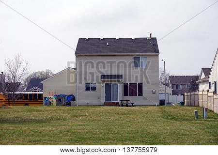 JOLIET, ILLINOIS / UNITED STATES - MARCH 15, 2016: A small tract home in the Aspen Meadows subdivision of west Joliet.