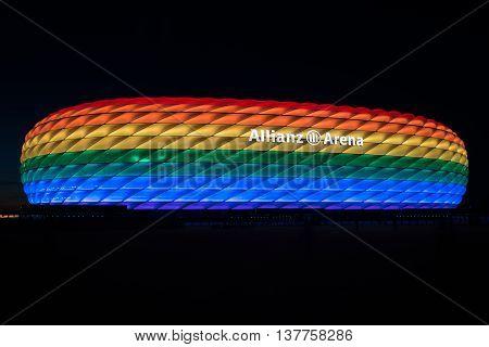 MUNICH, GERMANY - JULY 9, 2016: Allianz Arena illuminated in rainbow light on Christopher Street Day