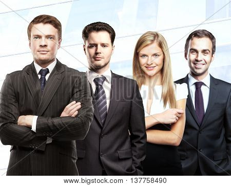 Teamwork concept with attractive white businessmen and woman on light background