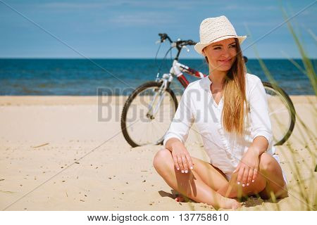 Girl With Bike On Beach.