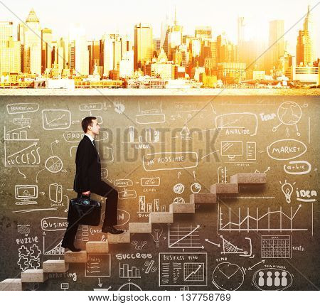 businessman walking upstairs on concrete ladder with business sketch underneath