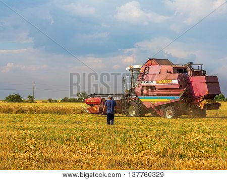 July 9, 2016. Odessa Region, Ukraine. Ukrainian Farmers Are Reaping The Wheat Harvest In The Fields