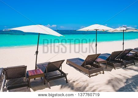 White sand beach with umbrellas Boracay island Philippines
