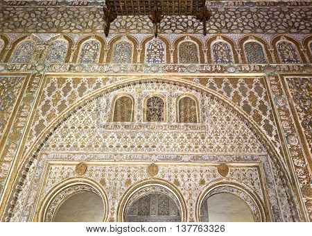 SEVILLE, SPAIN - September 12, 2015: The splendour of the mudejar civil architecture and caliphal art Alcazar of Seville on September 12, 2015 in Seville, Spain