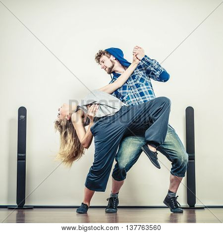 Two modern dancers couple woman and man dancing. Urban lifestyle. Hip-hop generation.