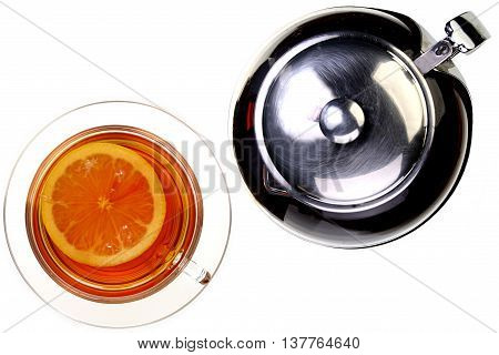 Cup of tea with lemon and brewing teapot on white backrgound with clipping path