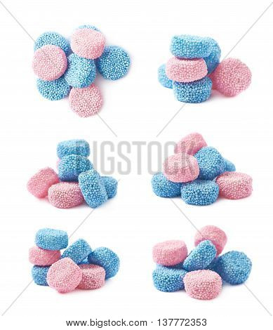 Pink and blue gelatin based cylinder shaped candies composition, isolated over the white background, set of six different foreshortenings
