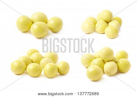 Pile of sugar coated ball candies isolated over the white background, set of four different foreshortenings