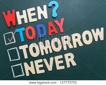 Business time management concept - When? Today Tomorrow or Never with checkboxes and red marking on blackboard