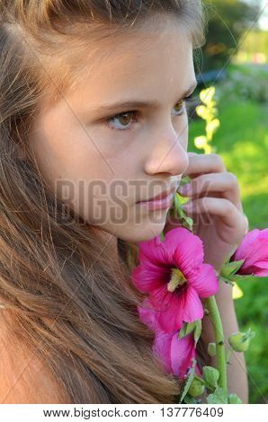Young girl with her hair next to her cheek