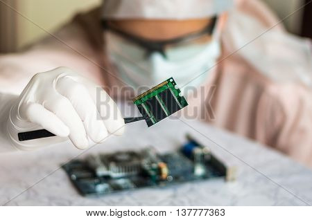 Scientist Repairs Electronic Circuit And Holding Damaged Electri