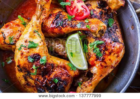 Grilled chicken legs lettuce and cherry tomatoes limet olives. Traditional cuisine. Mediterranean cuisine.