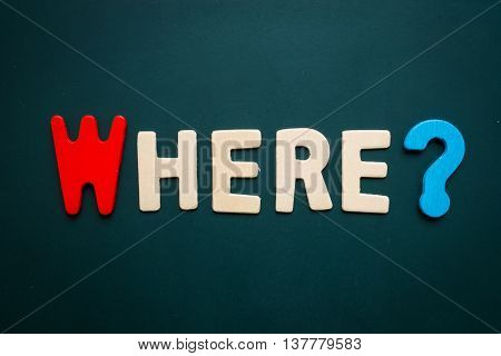 Text 'where' wording on blackboard - business concept of 5 WHs questions - problem solving - colorful alphabet made from wood