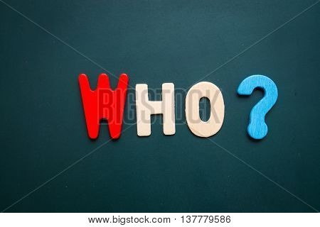 Text 'who' wording on blackboard - business concept of 5 WHs questions - problem solving - colorful alphabet made from wood